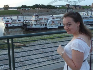 Emma on the Mississippi in front of some of those boat things in downtown Memphis